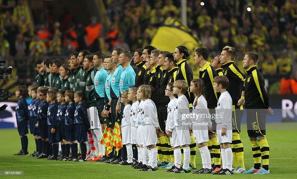The team of Dortmund (R) and Madrid (L) line up prior to the UEFA Champions League semi final first leg match between Borussia Dortmund and Real Madrid at Signal Iduna Park on April 24, 2013 in Dortmund, Germany.
