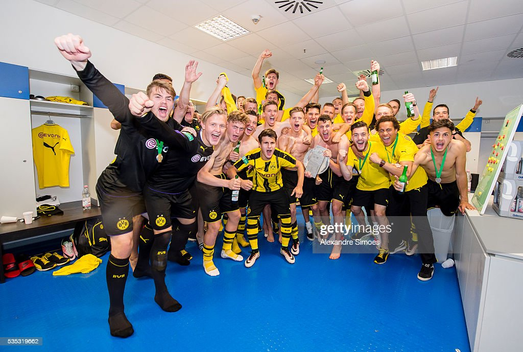 The team of Dortmund celebrate in the dressing room after the A Juniors German Championship Final match between 1899 Hoffenheim U19 and Borussia Dortmund U19 at Wirsol Rhein-Neckar-Arena on May 29, 2016 in Sinsheim, Germany.