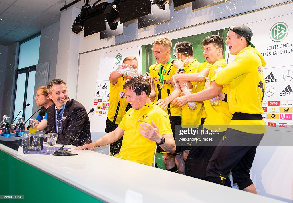 The team of Dortmund celebrate with the manager Hannes Wolf during the press conference after the A Juniors German Championship Final match between 1899 Hoffenheim U19 and Borussia Dortmund U19 at Wirsol Rhein-Neckar-Arena on May 29, 2016 in Sinsheim, Germany.