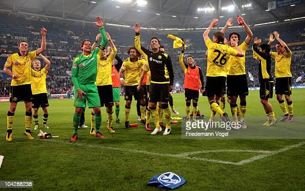 The team of Dortmund celebrates after winning the Bundesliga match between FC Schalke 04 and Borussia Dortmund at Veltins Arena on September 19 2010...