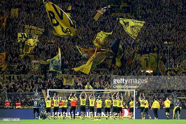 The team of Dortmund celebrates after winning the Bundesliga match between Borussia Dortmund and FC Schalke 04 at Signal Iduna Park on November 8...