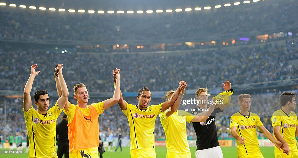 The team of Dortmund celebrates the victory after the DFB Cup match between TSV 1860 Muenchen and Borussia Dortmund at Allianz Arena on September 24, 2013 in Munich, Germany.
