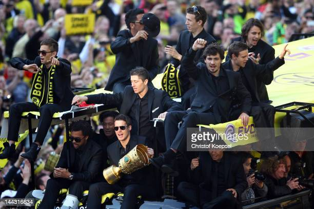 The team of Dortmund celebrates with the trophies during a parade at Borsigplatz celebrating Borussia Dortmund's Bundesliga and DFB Cup win on May 13...