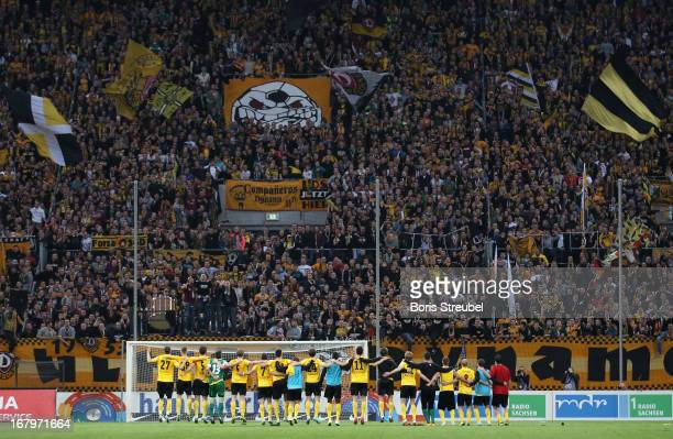 The team of Dresden celebrates with their fans after winning the Second Bundesliga match between SG Dynamo Dresden and SC Paderborn 07 at...