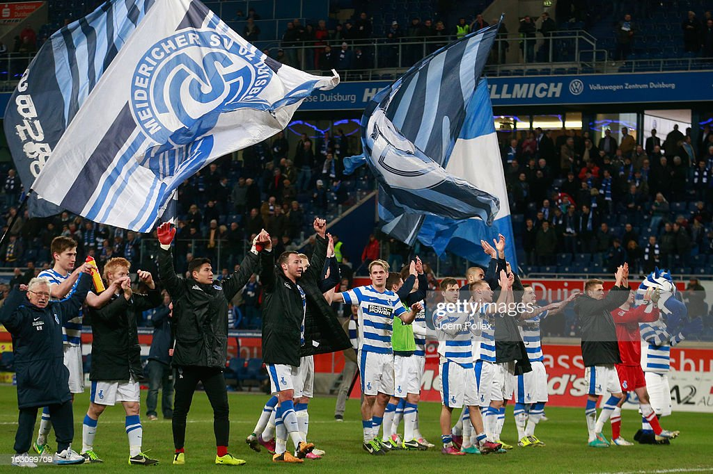 The team of Duisburg celebrates after winning the Second Bundesliga match between MSV Duisburg and Eintracht Braunschweig at Schauinsland-Reisen-Arena on March 4, 2013 in Duisburg, Germany.