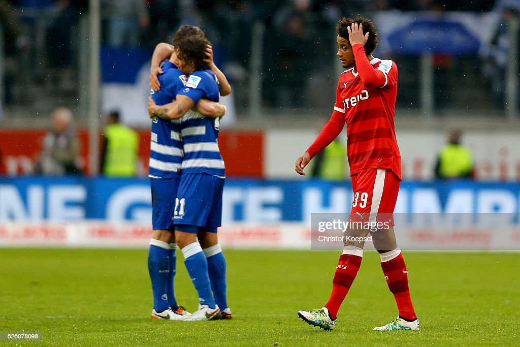 The team of Duisburg celebrates and Emmanuel Iyoha of Duesselodr looks dejected after the 2. Bundesliga match between MSV Duisburg and Fortuna Duesseldorf at Schauinsland-Reisen-Arena on April 29, 2016 in Duisburg, Germany. The match between Duisburg and Duesseldorf ended 2-1.