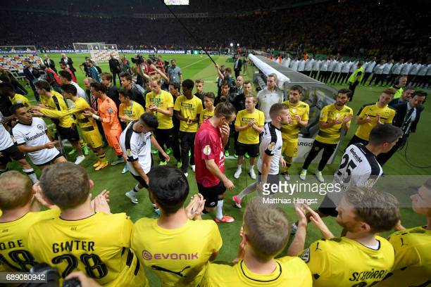 The team of Eintracht Frankfurt walks through the team of Borussia Dortmund after losing the DFB Cup Final 2017 between Eintracht Frankfurt and...