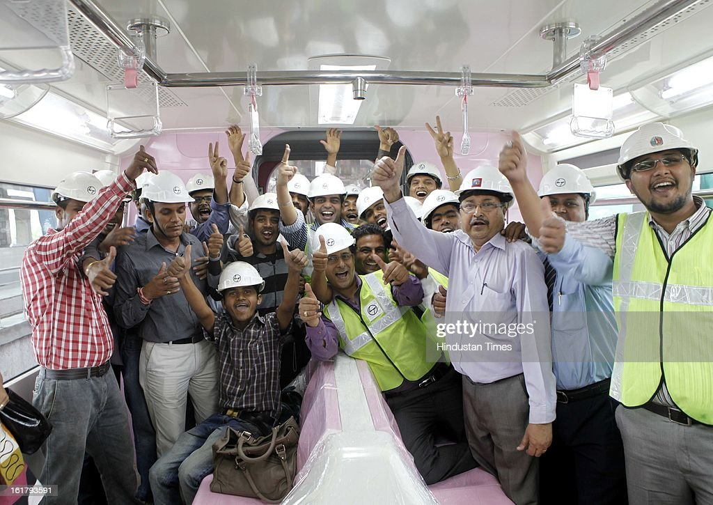 The team of employees which worked on the mono rail project in a jubilant mood after mono rail train took passengers on a trial run from Wadala to Chembur on February 16, 2013 in Mumbai, India. The 19.54 km long Chembur-Wadala-Jacob Circle monorail project will be the country's first monorail route and is expected to be operational by August this year.