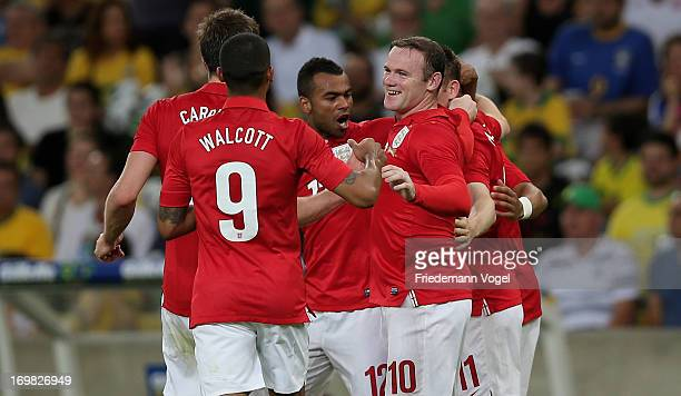 The team of England celebrates scoring the first goal during the International Friendly match between Brazil and England at Maracana on June 2 2013...