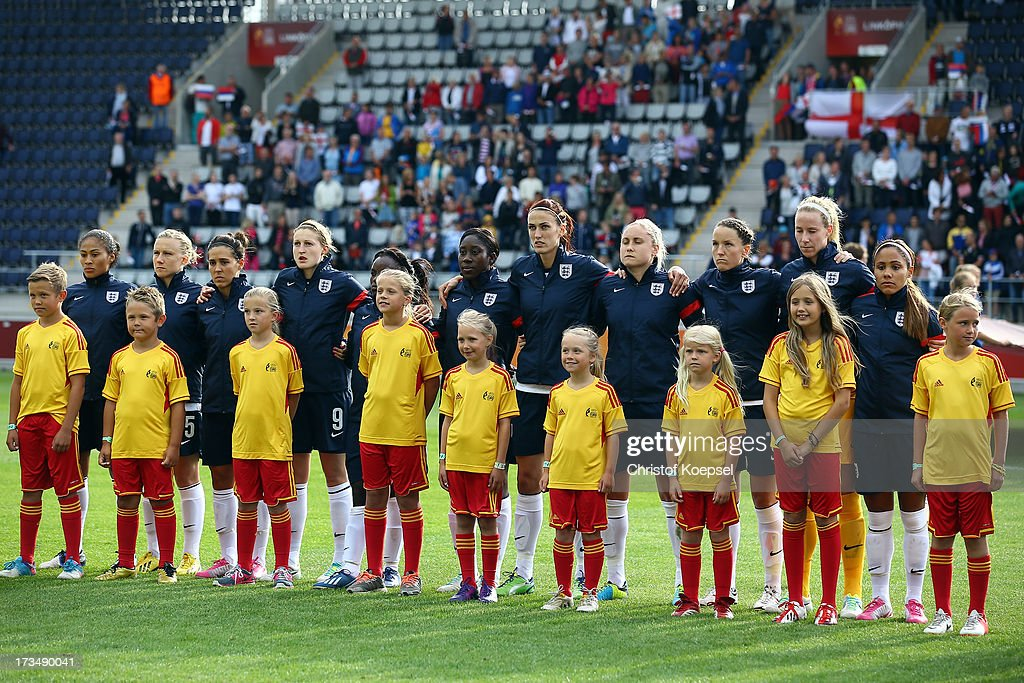 The team of England stands for the national anthem prior to the UEFA Women's EURO 2013 Group C match between England and Russia at Linkoping Arena on July 15, 2013 in Linkoping, Sweden.