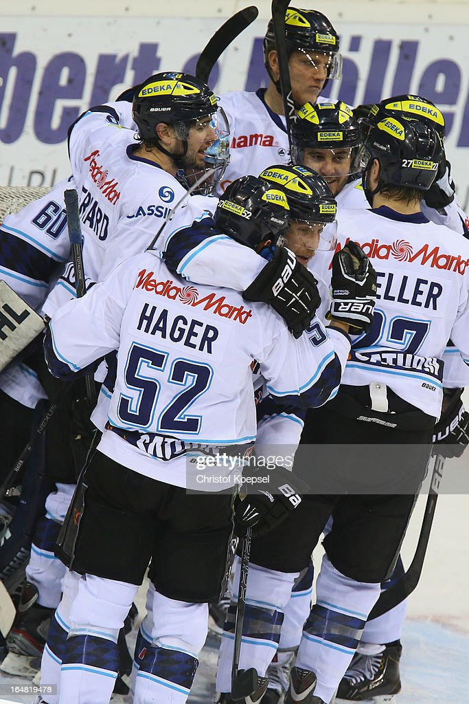 The team of ERC Ingolstadt celebrates the 2-1 victory after the fifth DEL Play-Off-match between Krefeld Pinguine and ERC Ingolstadt at Koenigspalast on March 28, 2013 in Wuppertal, Germany.