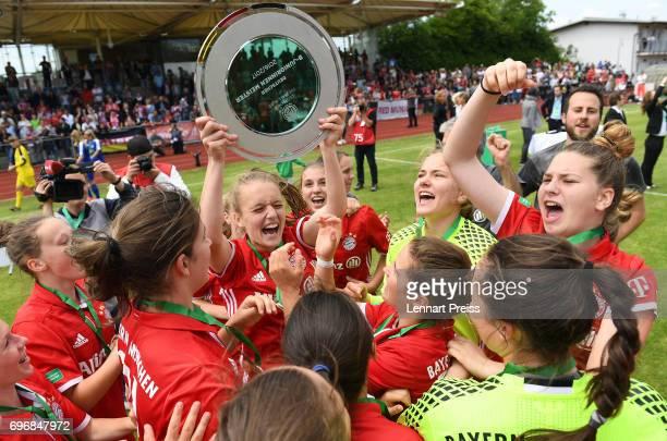 The team of FC Bayern Muenchen celebrates wining the B Junior Girl's German Championship Final against 1 FFC Turbine Potsdam at Sportpark Aschheim on...