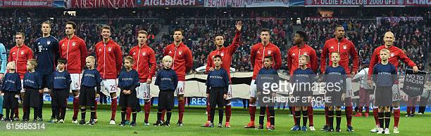 The team of FC Bayern Munich Bayern Munich's defender Philipp Lahm Bayern Munich's goalkeeper Manuel Neuer Bayern Munich's defender Mats Hummels...