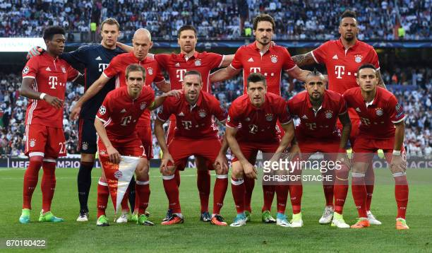 The team of FC Bayern Munich first row Bayern Munich's defender Philipp Lahm Bayern Munich's French midfielder Franck Ribery Bayern Munich's Polish...