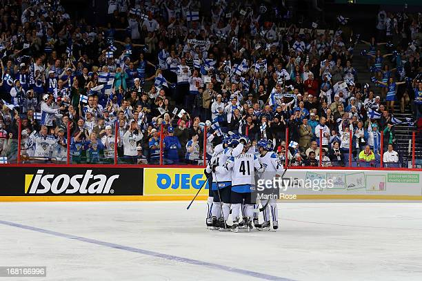 The team of Finland celebrate their 3rd goal during the IIHF World Championship group H match between Finland and France at Hartwall Areena on May 6...