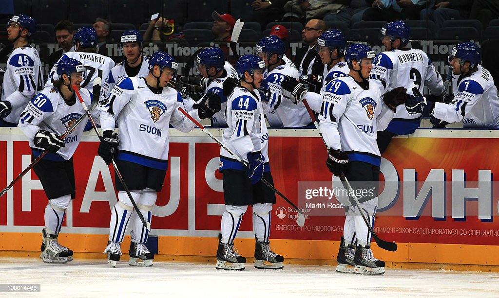 The team of Finland celebrate their opening goal during the IIHF World Championship quarter final match between Finland and Czech Republic at Lanxess Arena on May 20, 2010 in Cologne, Germany.