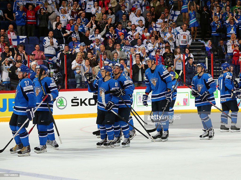The team of Finland celebrate winning in over time during the IIHF World Championship group H match between Latvia and Finland at Hartwall Areena on May 14, 2013 in Helsinki, Finland.