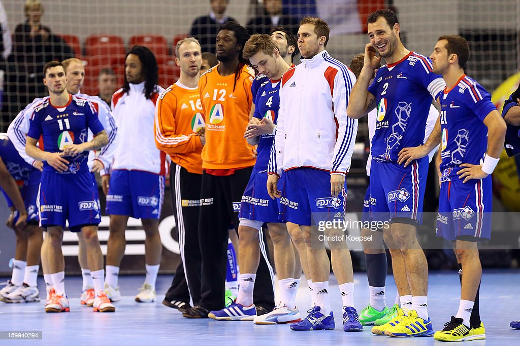 The team of France look dejected after losing 23-30 the quarterfinal match between France and Croatia at Pabellon Principe Felipe Arena on January 23, 2013 in Barcelona, Spain.