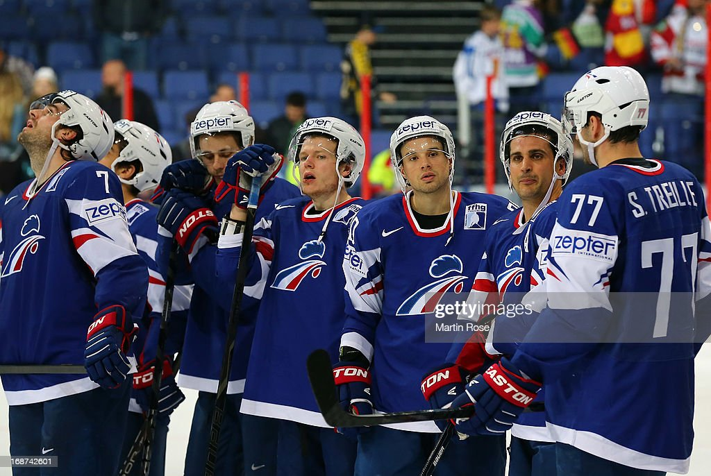 The team of France look dejected after the IIHF World Championship group H match between France and Germany at Hartwall Areena on May 14, 2013 in Helsinki, Finland.
