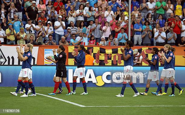 The team of France looks dejected after the FIFA Women's World Cup 2011 3rd place playoff match between Sweden and France at RheinNeckar Arena on...