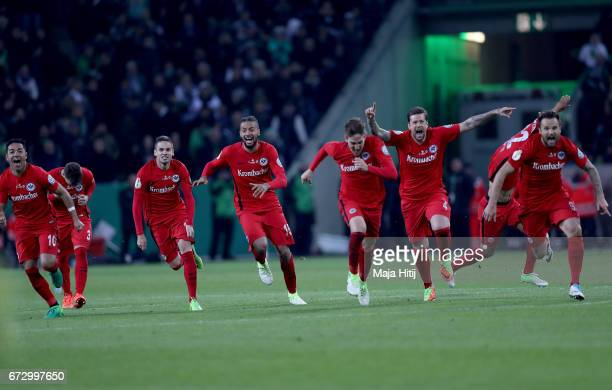 The team of Frankfurt celebrate during penalty shoot out during the DFB Cup semi final match between Borussia Moenchengladbach and Eintracht...