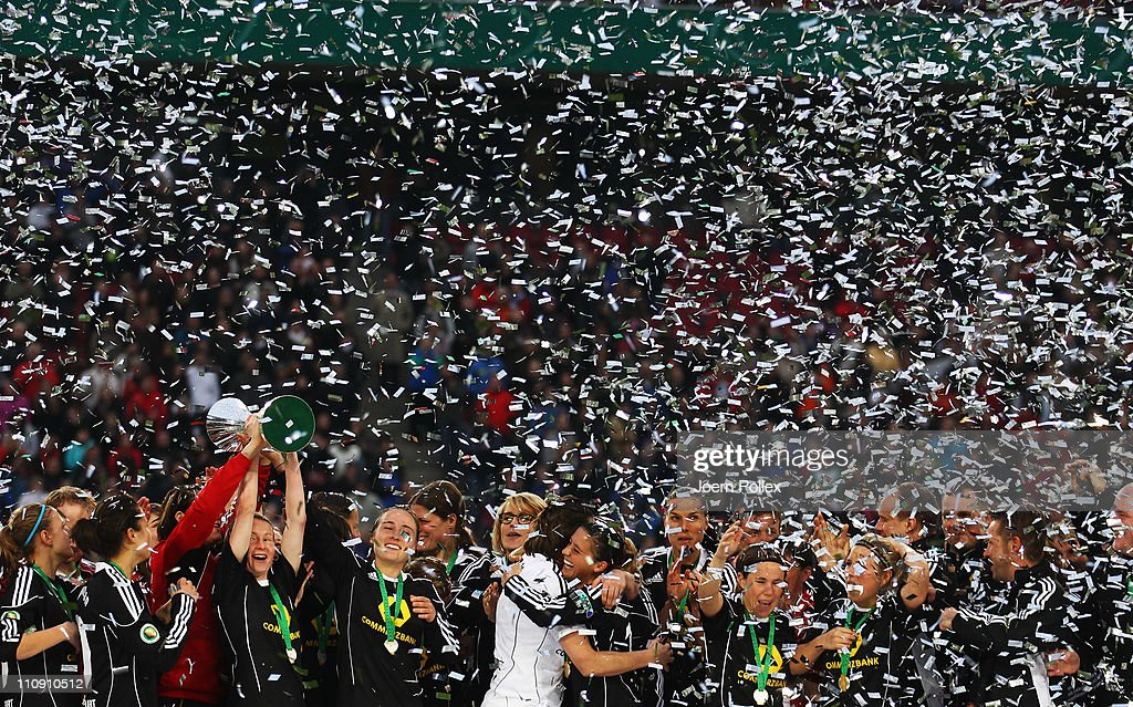 The team of Frankfurt celebrates with the cup after winning the DFB Women's Cup final match between 1. FFC Frankfurt and Turbine Potsdam at RheinEnergie stadium on March 26, 2011 in Cologne, Germany.