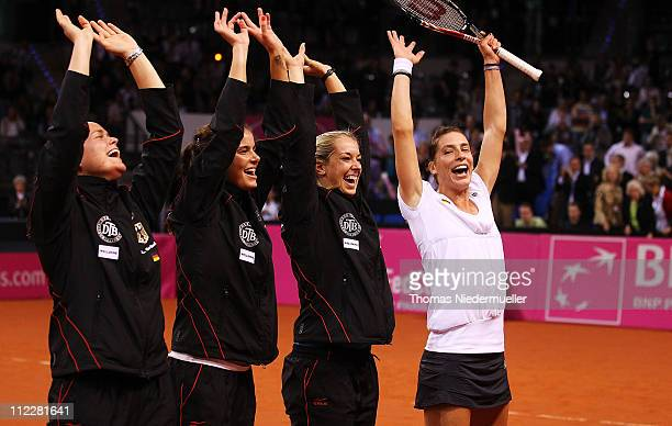 The team of Gemany AnnaLena Groenefeld Julia Goerges Sabine Lisicki and Andrea Petkovic celebrate during the second day of the Fed Cup match between...