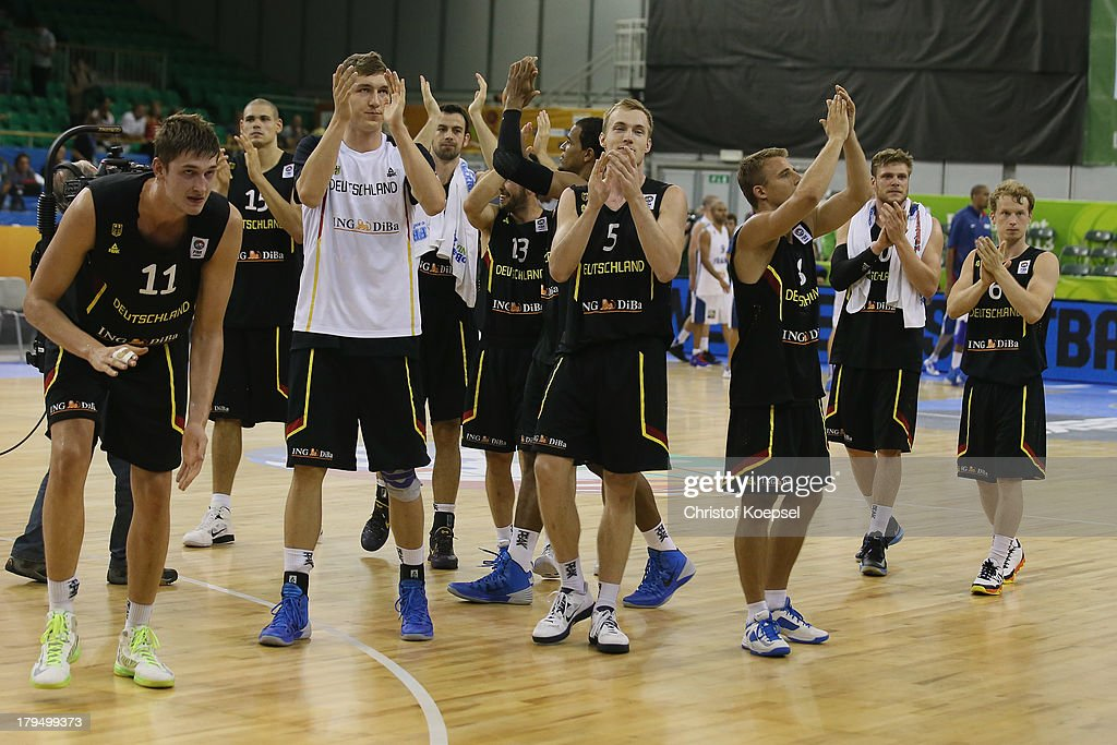 The team of Gemany celebrates after the FIBA European Championships 2013 first round group A match between France and Germany at Tivoli Arena on September 4, 2013 in Ljubljana, Slovenia. The match betweenFrance and Germany ended 74-80.