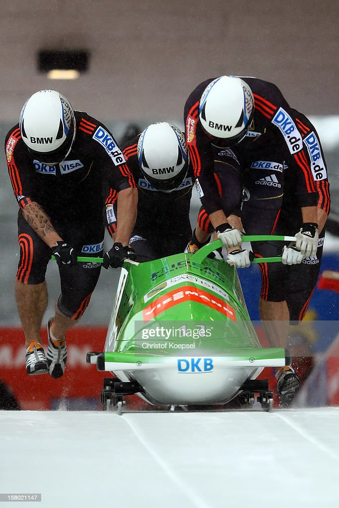 The team of Germany 1 with Thomas Florschuetz, Andreas Bredau, Kevin Kuske and Thomas Blaschek sprint during the four men's bob competition during the FIBT Bob & Skeleton World Cup at Bobbahn Winterberg on December 9, 2012 in Winterberg, Germany.