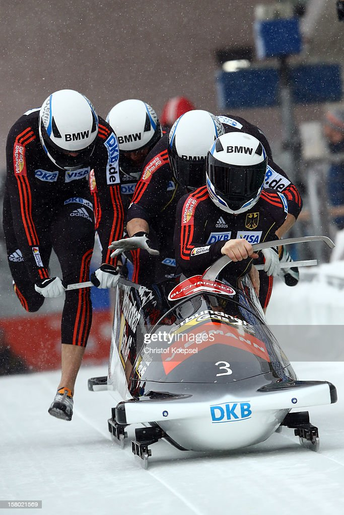 The team of Germany 2 with Manuel Machata, Gregor Bermbach, Christian Friedrich and Christian Poser sprints during the four men's bob competition during the FIBT Bob & Skeleton World Cup at Bobbahn Winterberg on December 9, 2012 in Winterberg, Germany.