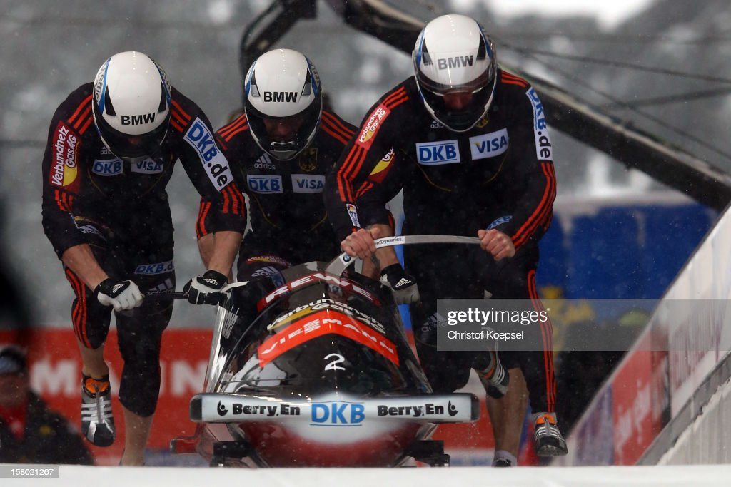 The team of Germany 3 with Maximilian Arndt, Alex Mann, Alexander Roediof Germanyand Martin Putze sprint during the four men's bob competition during the FIBT Bob & Skeleton World Cup at Bobbahn Winterberg on December 9, 2012 in Winterberg, Germany.