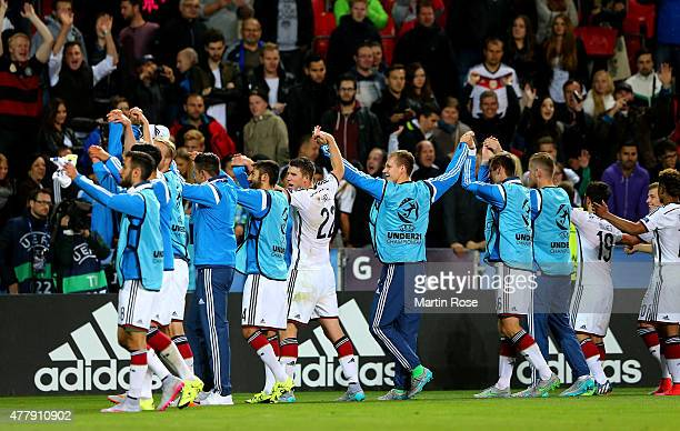 The team of Germany celebrate after the UEFA European Under21 Group A match between Germany and Denmark at Eden Stadium on June 20 2015 in Prague...