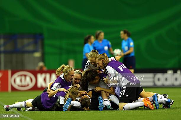 The team of Germany celebrate after winning the FIFA U20 Women's World Cup 2014 final match between Nigeria and Germany at Olympic Stadium on August...