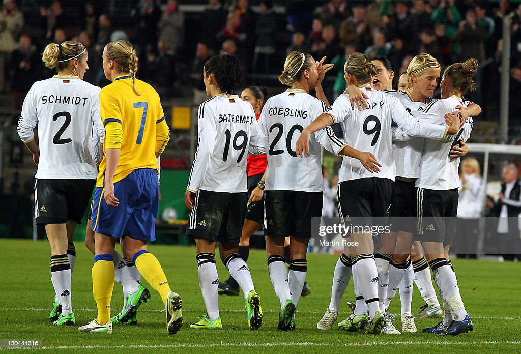The team of Germany celebrate their opening goal during the Women's International friendly match between Germany and Sweden on October 26, 2011 in Hamburg, Germany.