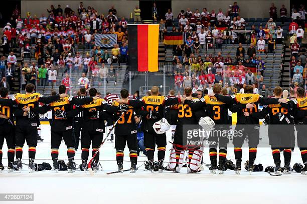 The team of Germany celebrate victory after the IIHF World Championship group A match between Czech Republic and Austria at o2 Arena on May 8 2015 in...