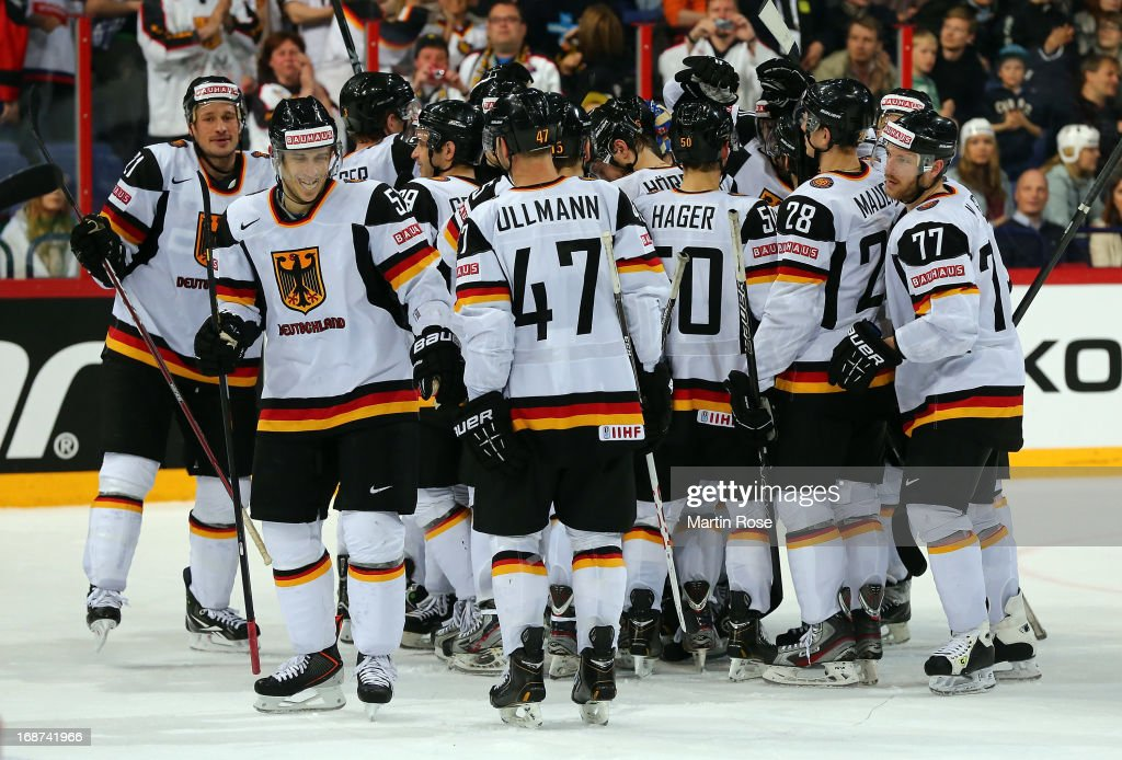 The team of Germany celebrates after the IIHF World Championship group H match between France and Germany at Hartwall Areena on May 14, 2013 in Helsinki, Finland.