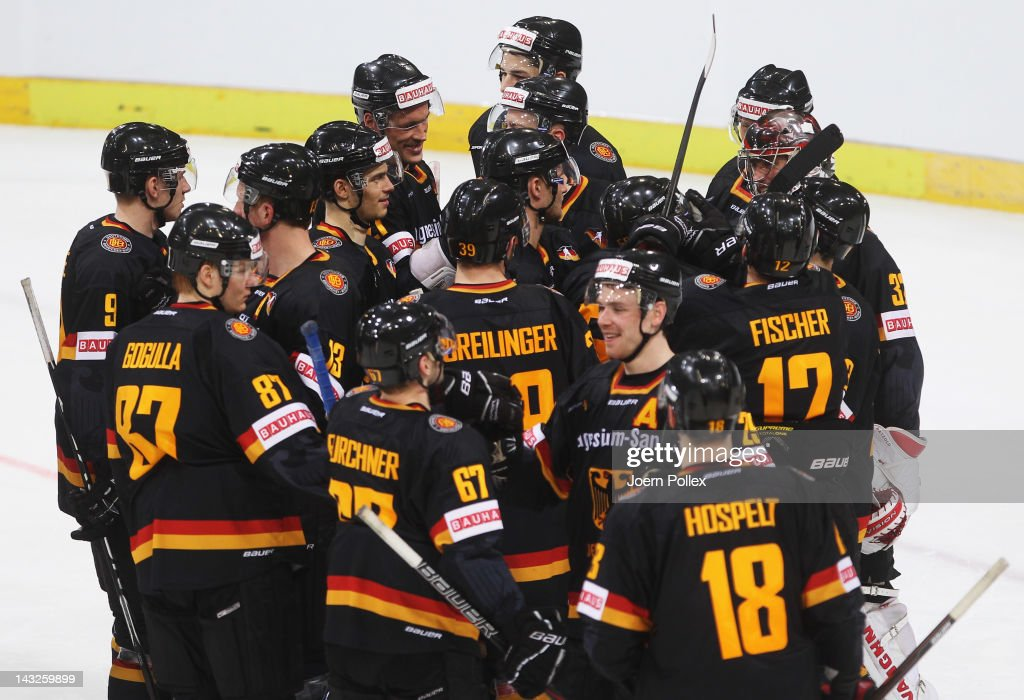 The team of Germany celebrates after winning the international friendly icehockey match between Germany and Denmark at TUI Arena on April 22 2012 in...