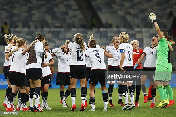 The team of Germany celebrates after winning the Women's Semi Final match between Canada and Germany on Day 11 of the Rio2016 Olympic Games at...