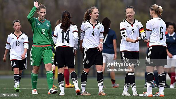 The team of Germany celebrates after winning their U17 girl's international friendly match against France on December 17 2015 in Duesseldorf Germany