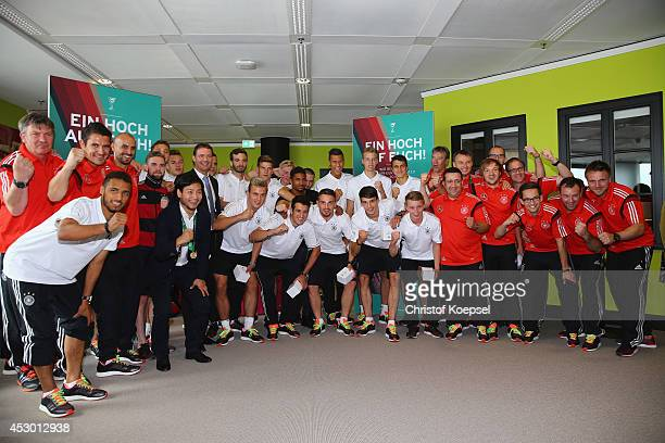 The team of Germany celebrates during the arrival of the U19 team of Germany at Frankfurt International Airport on August 1 2014 in Frankfurt am Main...