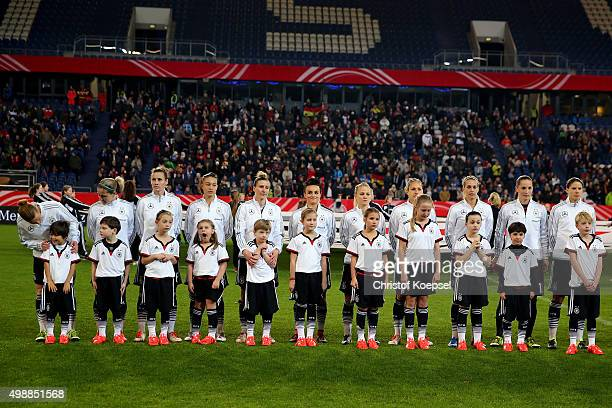 The team of Germany comes together for the national anthem prior to the Women's International Friendly match between Germany and England at...