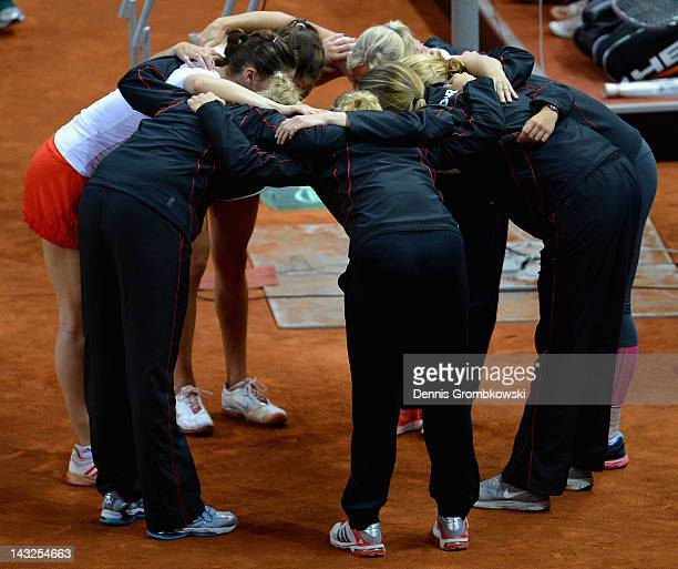 The team of Germany lines up in a circle during day two of the Federation Cup 2012 World Group PlayOff match between Germany and Australia at Porsche...