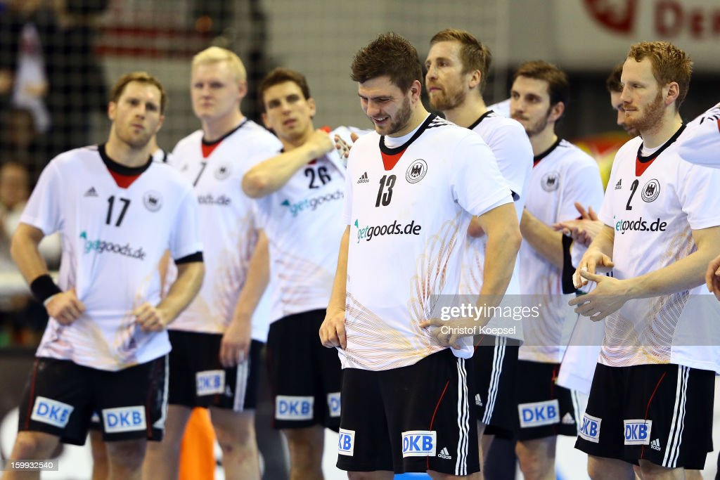The team of Germany look dejected after losing 24-28 the quarterfinal match between Spain and Germany at Pabellon Principe Felipe Arena on January 23, 2013 in Barcelona, Spain.