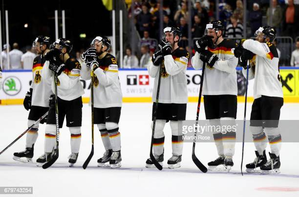 The team of Germany looks dejected after the 2017 IIHF Ice Hockey World Championship game between Germany and Sweden at Lanxess Arena on May 6 2017...