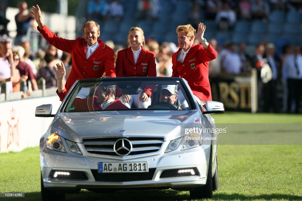 The team of Germany with Marco Kutscher JanneFriederike Meyer Marcus Ehning and Ludger Beerbaum wave to the fans during the MercedesBenz Prize as...
