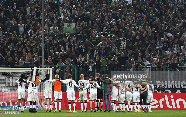 The team of Gladbach celebrate with the fans after the Bundesliga match between Borussia Moenchengladbach and SV Werder Bremen at Borussia Park on...