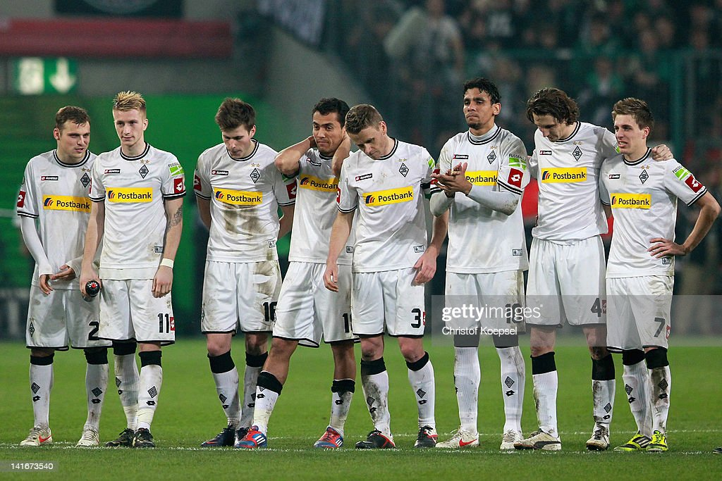 The team of Gladbach looks dejected during the penalty shoot-out after Dante missed scoring a penalty during the DFB Cup semi final match between Borussia Moenchengladbach and FC Bayern Muenchen at Borussia Park Stadium on March 21, 2012 in Moenchengladbach, Germany.