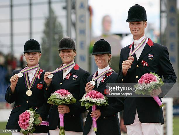 The team of Great Britain wins the silver medal in the Team Eventing and sho their medals with Zara Phillips Mary King Daisy Dick and William FoxPitt...