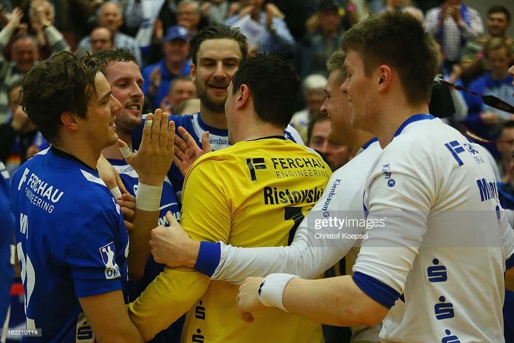 The team of Gummersbach celebrates goalkeeper Borko Ristovski (C) after winning 27-26 the DKB Handball Bundesliga match between VfL Gummersbach and FrischAuf Goeppingen at Eugen-Haas-Sporthalle on February 20, 2013 in Gummersbach, Germany.