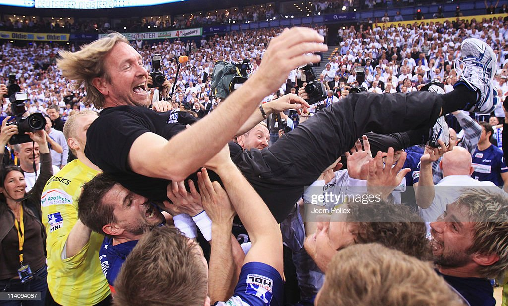 The team of Hamburg celebrates the German championship after the Toyota Handball Bundesliga match between HSV Hamburg and VfL Gummersbach at the o2...